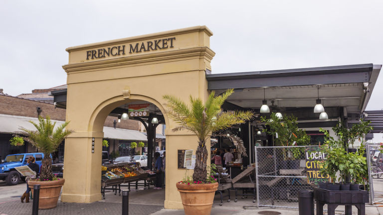 Traditional French Market at the French Quarter in the city of New Orleans, Louisiana. Photo via Shutterstock.
