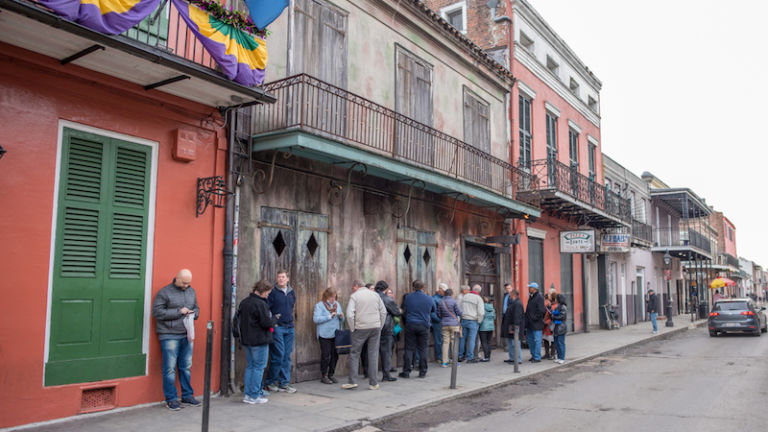 People wait in line outside of Preservation Hall in New Orleans. Photo by Shutterstock.