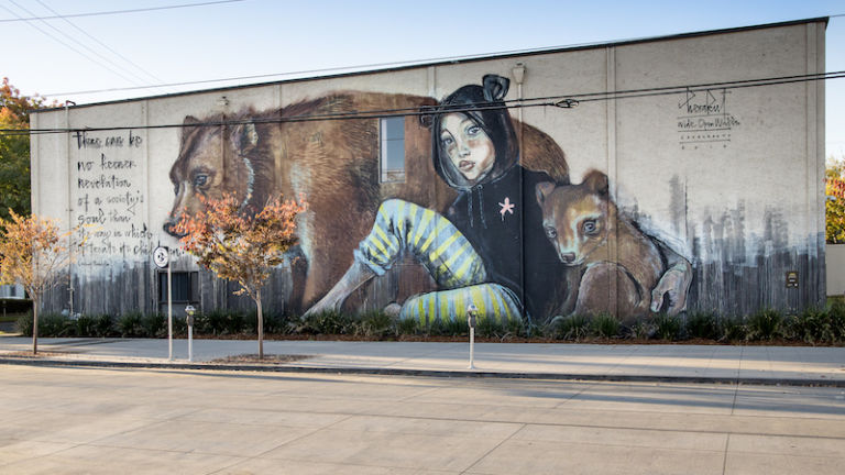 Mural created by street artist duo Herakut for 2018's Wide Open Walls in Sacramento, Calif. Photo by Mike Stalter.