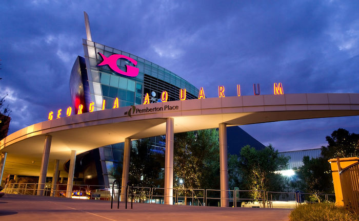 The Georgia Aquarium facade at night in Atlanta, Georgia. The boat shaped landmark is the world's largest aquarium with more than 8 million gallons of water. Photo by Shutterstock.