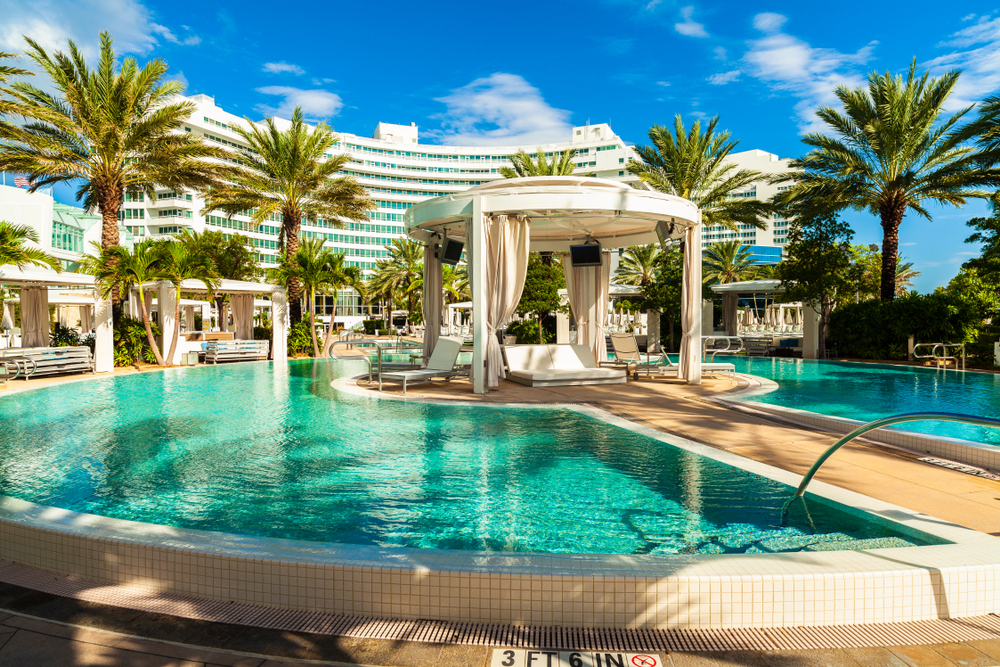 The Marvelous Music History of Miami Beach's Fontainebleau. The beautiful pool area of the historic art deco style Fontainebleau Hotel designed in the 1950s. Photo via Shutterstock.