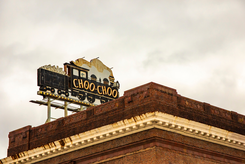 Sign for Chattanooga Choo Choo Hotel on top of landmark train station in Tennessee. Tennessee Whiskey Trail. Photo by Shutterstock.