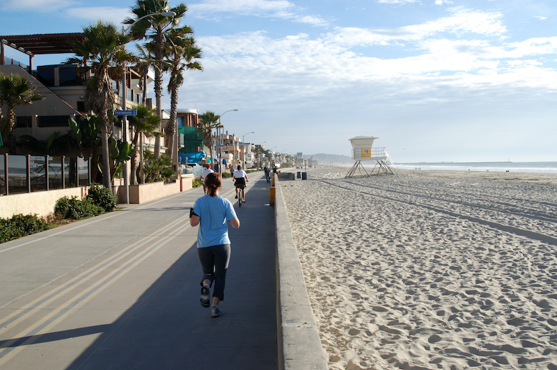 Joggers and cyclists on bicycle path and walkway along a beach; Mission Beach; San Diego, Calif. Photo by Shutterstock.