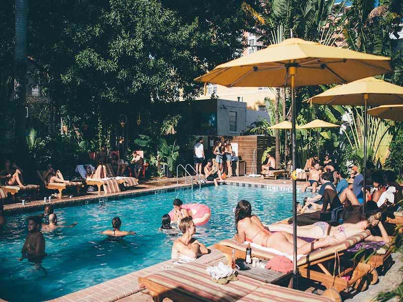 People around the pool at the Freehand Miami