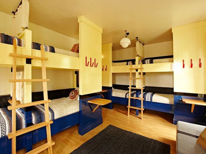 Room with eight bunks at the Freehand Miami