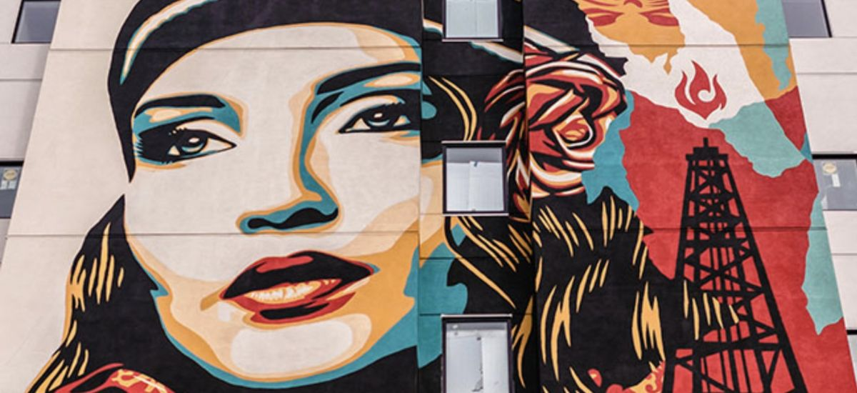 The Shepard Fairey five-story mural on the west side of the State Hotel.